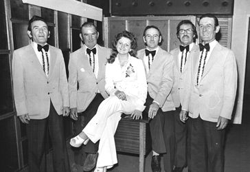 The five brothers with Country singer Ann Coates in the late 1970s